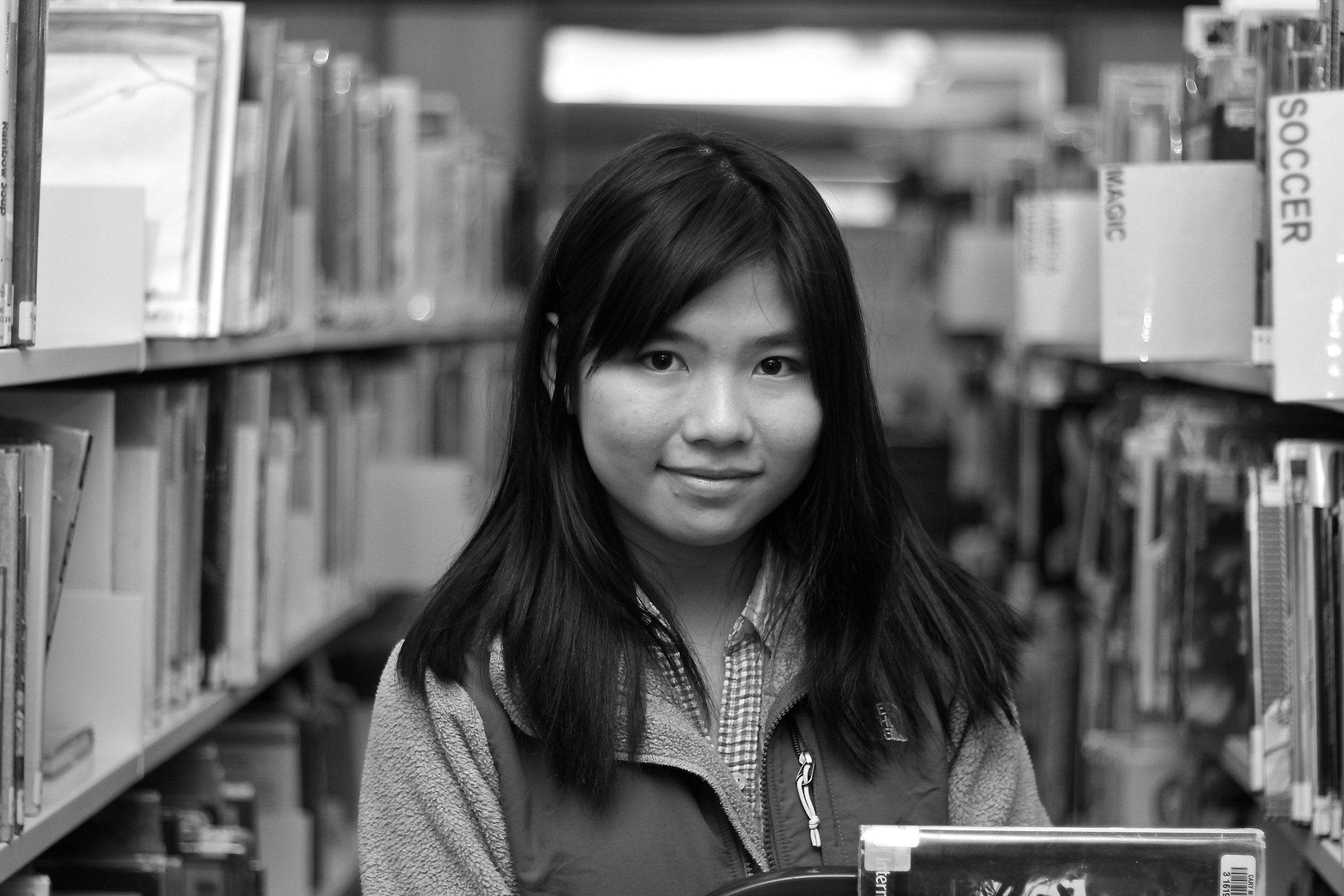 "She was in the library, shelving books.   ""Junior year is actually really busy, and now when I think back, it's good that I didn't take that much hard classes."""