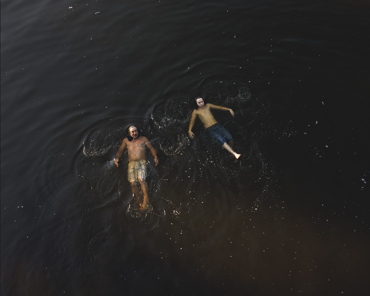 Father and Son Floating Down River, Chatham County