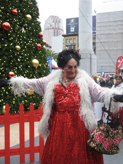 """The Countess Lola Montez serenades those gathered for the procession with her rendition of """"Christmas in San Francisco."""""""