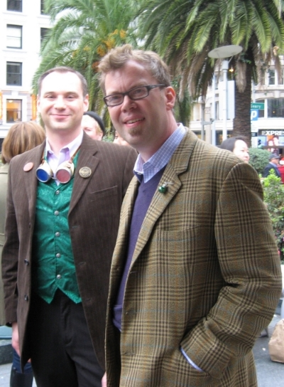 Matt Freedman of San Francisco Steampunks with Emperor's Bridge Campaign founder John Lumea at Union Square, San Francisco, for the procession to theCampaign's 2nd Annual Tannenbaum Toast.