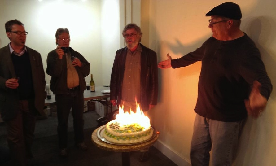 """""""Happy Birthday, Emperor Norton! Happy Birthday to you!"""" (l to r): Emperor's Bridge Campaign founder John Lumea; partyguest; Joseph Amster, of  Emperor Norton's Fantastic San Francisco Time Machine , in street clothes; and Gav Shelton, the Baker of the Cake (who also has a nice set of pipes!)"""