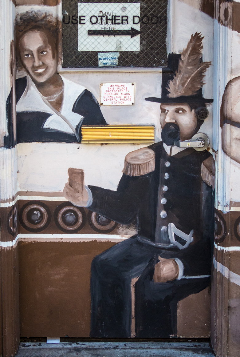 Detail of San Francisco Chocolate Factory mural (2005-6) by Jerry Warmsley, Jr., and Alyssa Morgan. Lost, 2016.  Previously located at the Factory's former offices and retail shop at 286 12th Street, San Francisco. Photograph  ©  2014 Larry Jones. Source:  Street Art SF . To view the full mural, click  here .