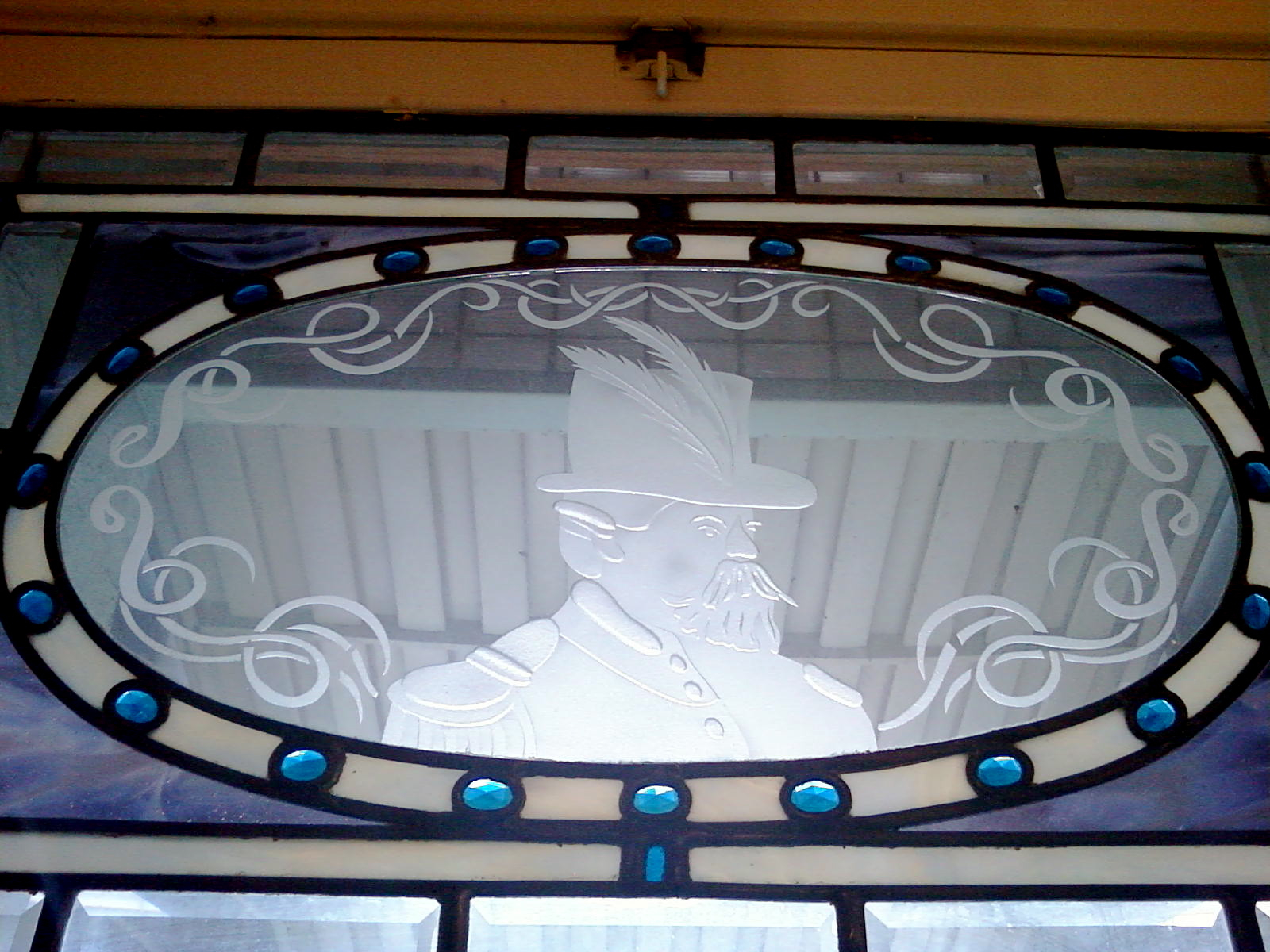 Glass etching in entry transom at the Emperor Norton Inn, 615 Post Street, San Francisco.  Creator and date unknown. Photograph  ©  2010  D. Huw Richardson .