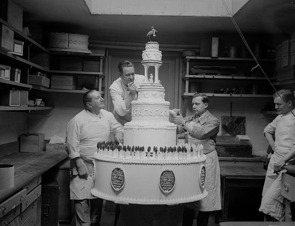 Piping the cake for Queen Charlotte's Birthday Ball , a charity event, c.1930, in support of Queen Charlotte's Maternity Hospital, in Hammersmith, London.