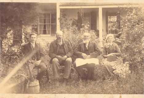 At the Champlin Ranch house (1856) , in 1891 or 1892. Left to right: Charles C. Champlin (1876-1965); his father, Asahel Warner Champlin (1846-1926); his grandfather, Charles Chaffee Champlin (1812-1892); and his grandmother, Sara Bartlett Champlin (1820-1898). Source:  ChamplinRanch.com