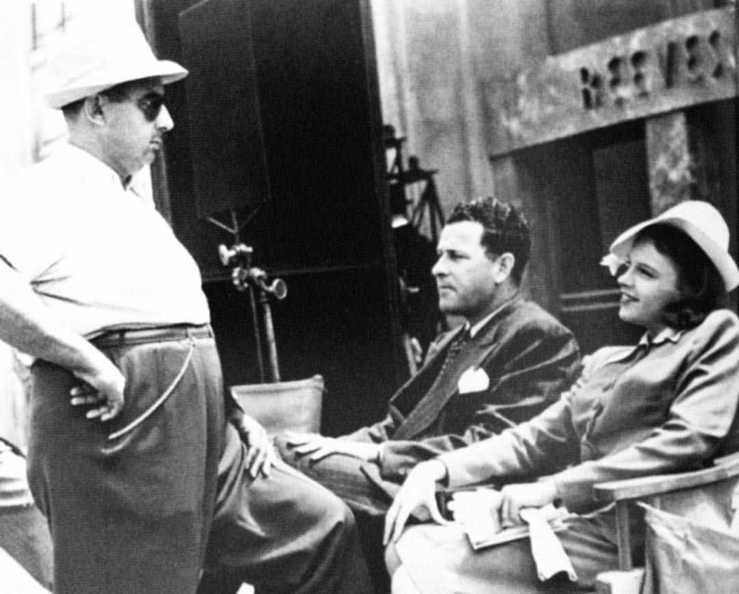 Roger Edens (center) with Judy Garland and director Norman Taurog on the set of  Little Nellie Kelly , 1938.  Source:  fansofjoots .