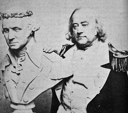 Photograph of  Frederick Coombs a.k.a. George Washington II  with bust of George Washington, c.1865. Source: San Francisco Public Library.