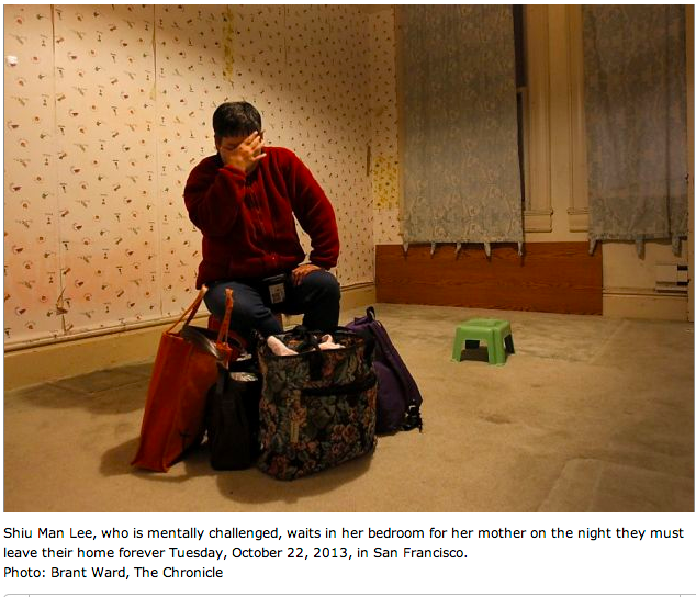 Shiu Man Lee, the disabled child of the Lee family, waiting to leave the apartment that she had lived in for 34 years.