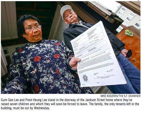 Gum Gee Lee and Poon Heung Lee stand in the doorway of the Jackson Street home where they've raised seven children and which they were forced to leave.