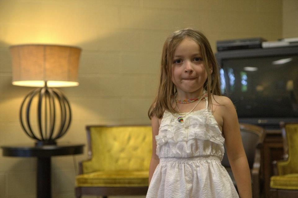 This is a shot I quickly took on my Rebel when I had a free moment. This was from my first year of doing other people's weddings. Poorly lit, grainy, colors are all off (aside from my daughter not having her hair done and making a face).