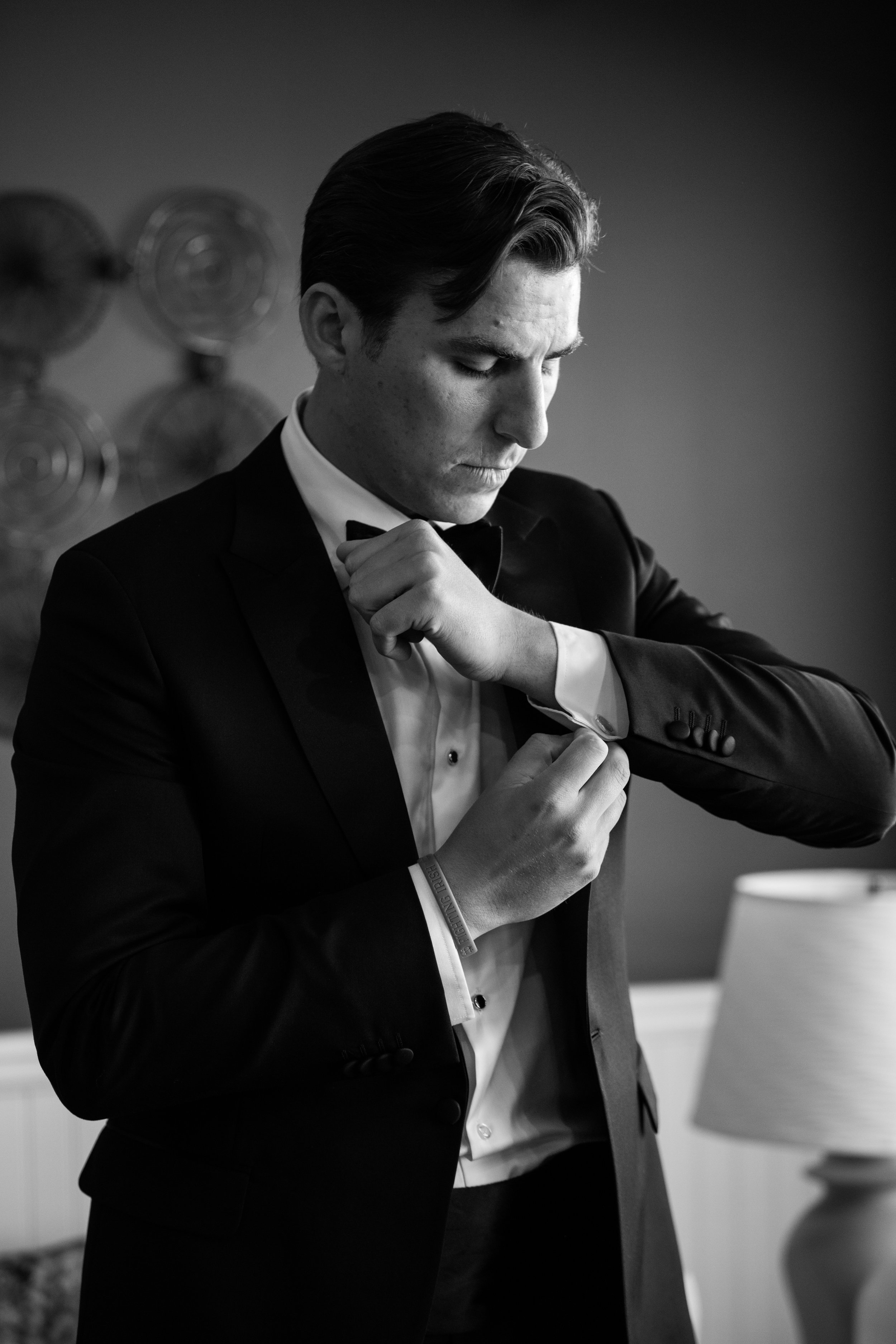 I get sent to take photos of the guys getting ready all the time. I love putting grooms right by the window and working with that dramatic lighting. Taken for Jennifer Mayo Studios.