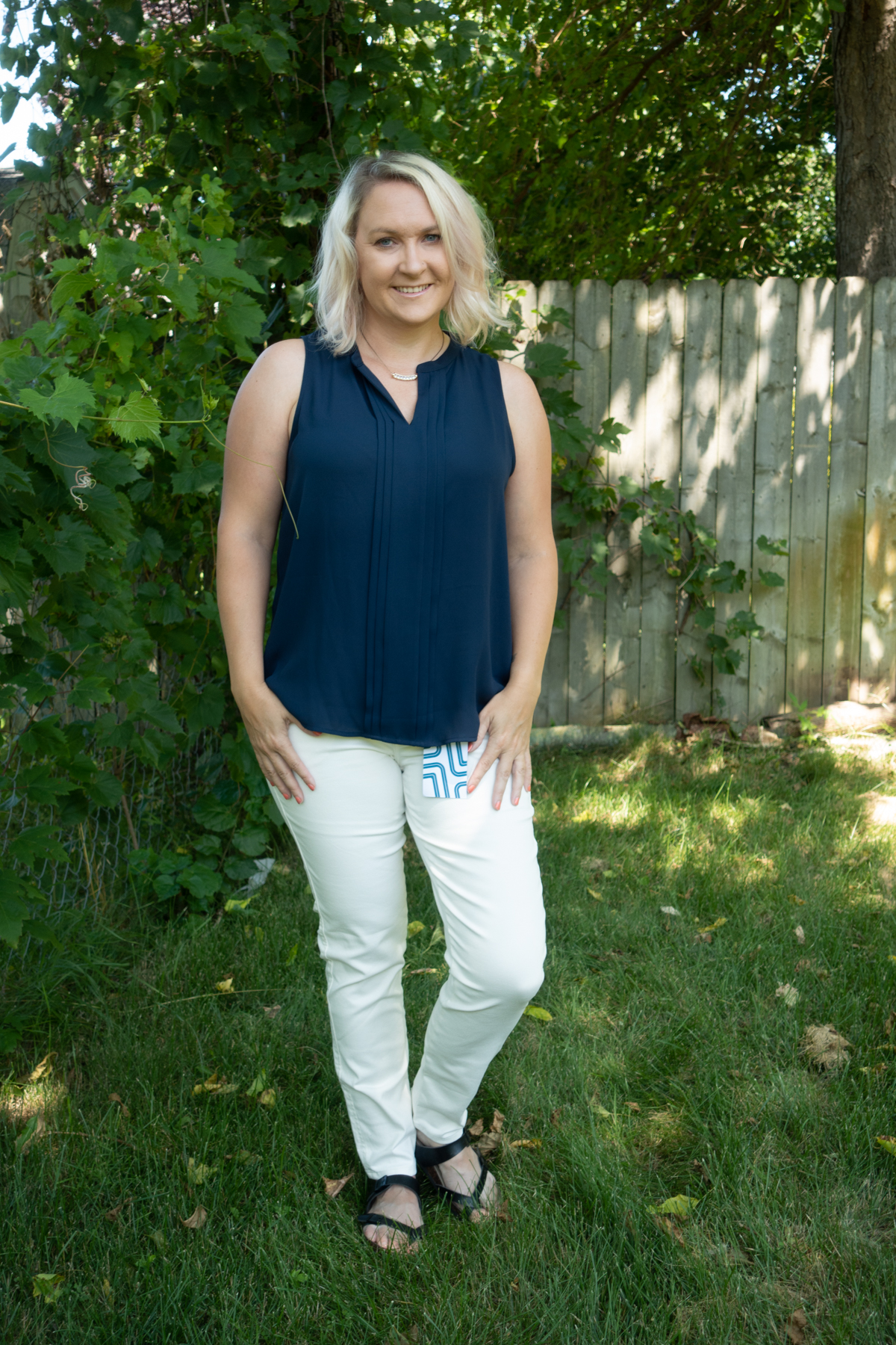 - Blue sleeveless top with the same white dress pants