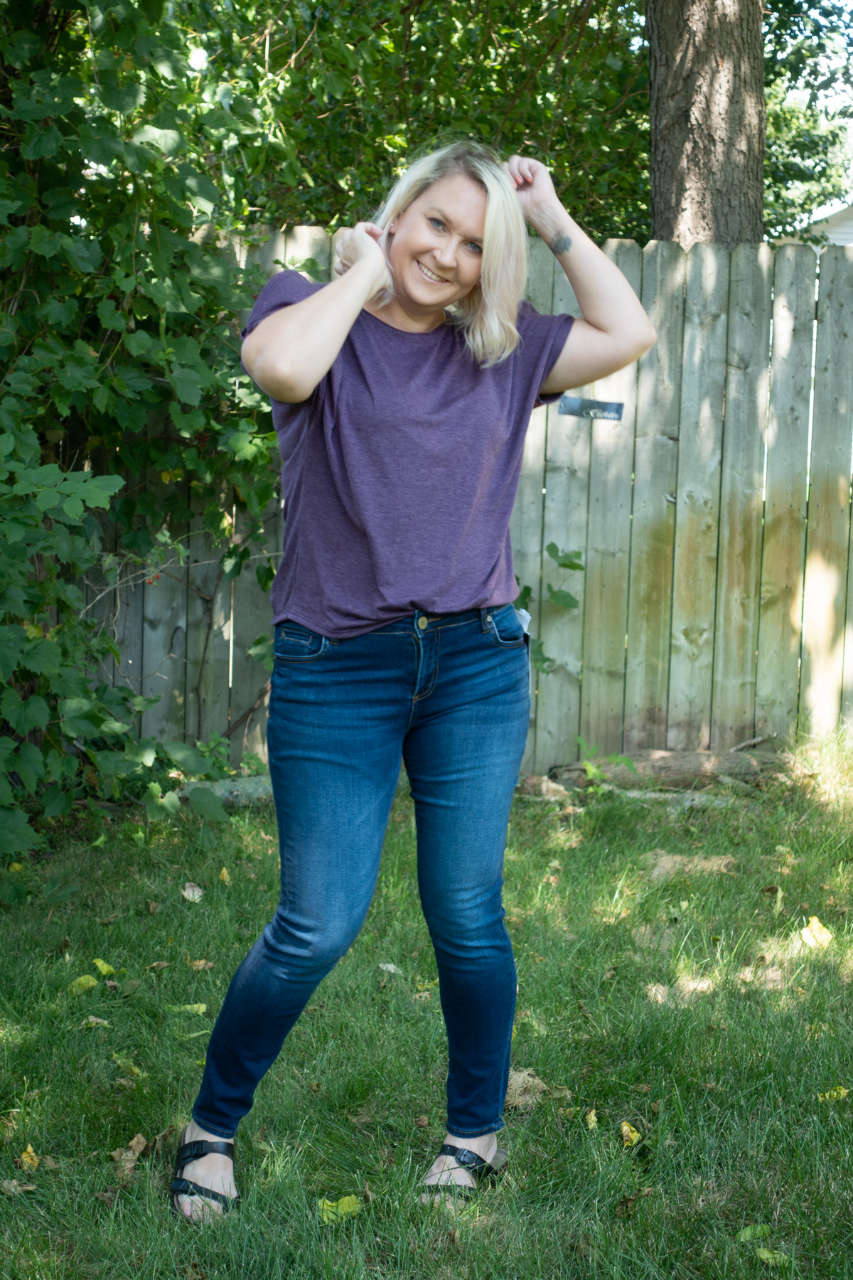 - Purple cut sleeve shirt and stretch skinny jeans