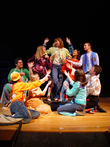 """Front and center in Godspell during my sophomore year of high school (note the bad perm, bangs and braces.) What I consider to my first """"serious"""" stepping stone towards committing to a legitimate lifelong acting career."""