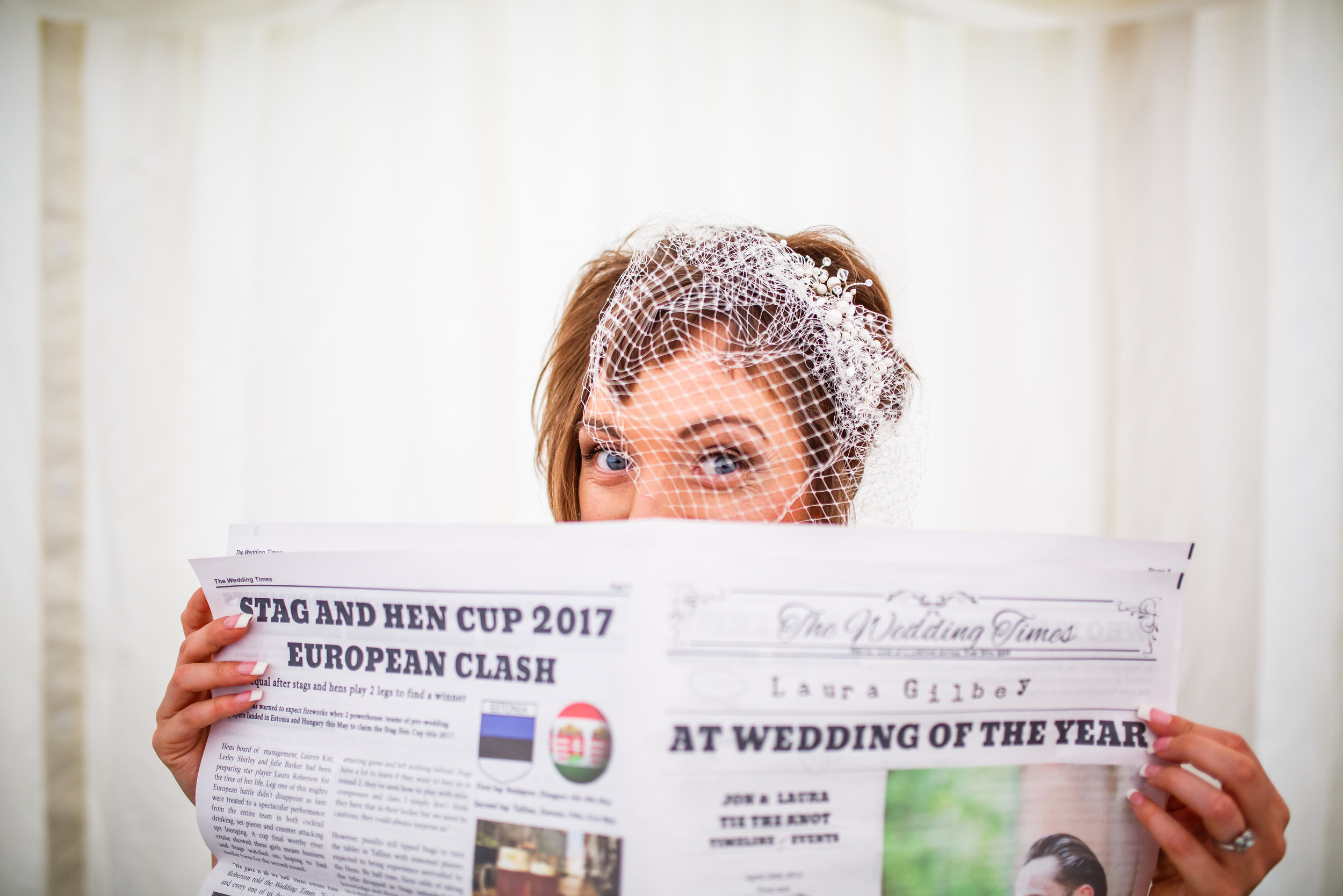 The bride trying to hide from my lens…..still got this special moment