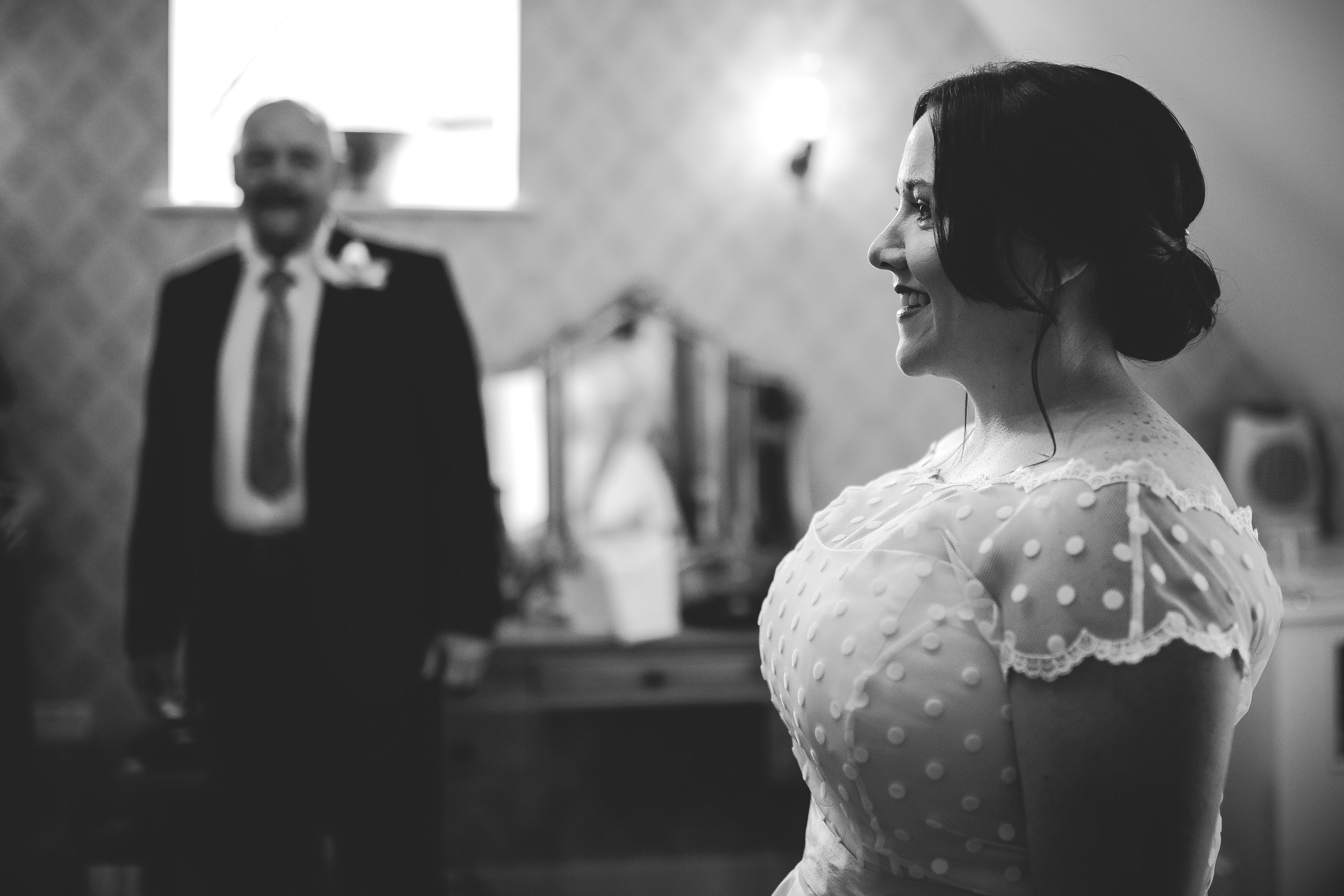 I adore this shot…..and would never have happened if I didn't turn up early and offer my services because I was there. We never arranged to do bridal prep shots….the bride was a shy and self conscious lady who wasn't sure. But as I was there, they invited me in and I got this wonderful shot of Dad seeing his beautiful daughter just before they were about to go to the ceremony at  Bassmead Manor Barns