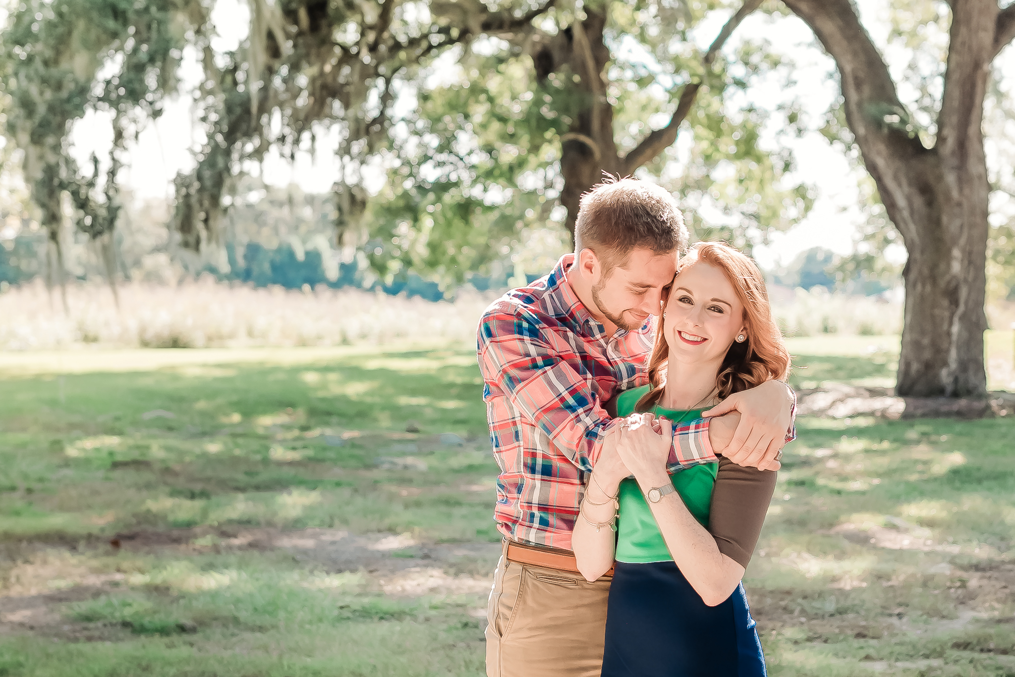 Natural, romantic engagement photos under live oaks and spanish moss, Charleston SC Engagement Photography