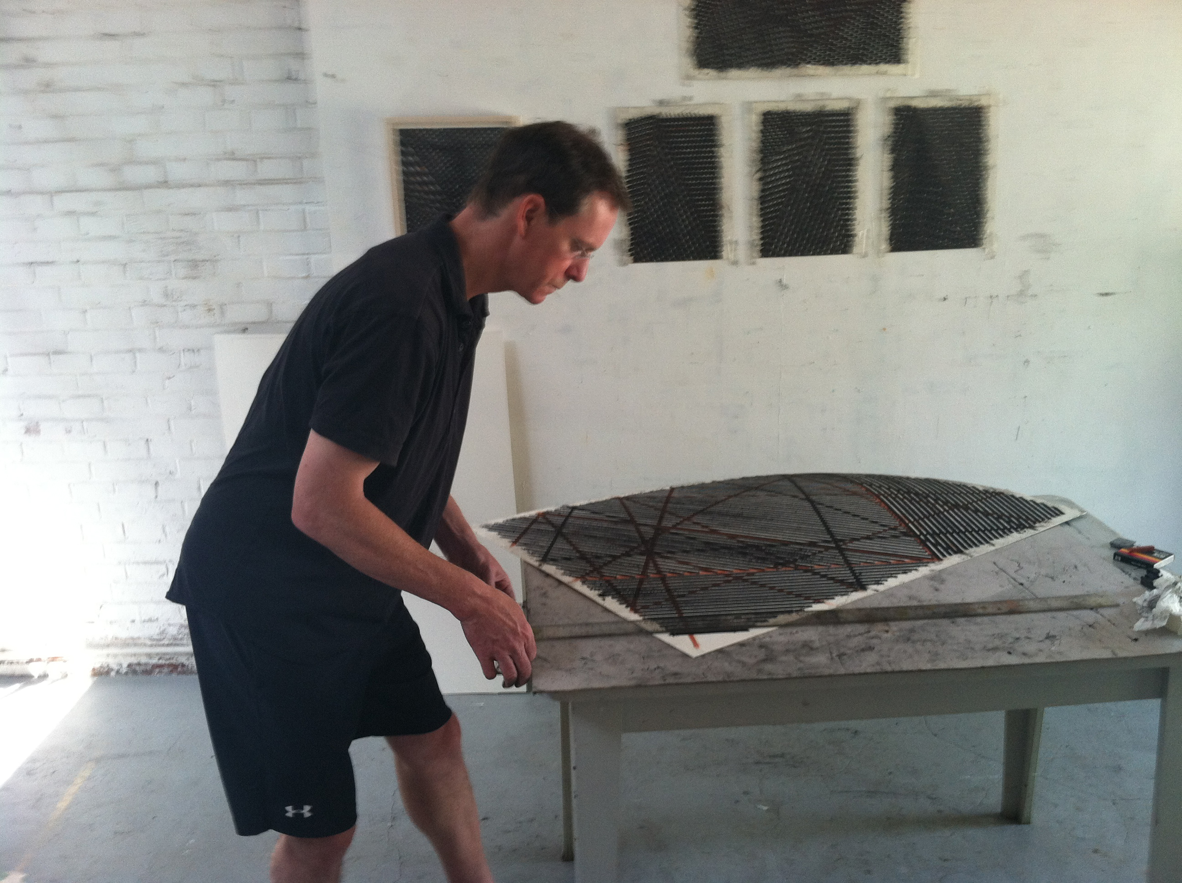 "Stroud at work during at work on drawings that later served as the foundation for his ""Open City"" paintings at Red Gate's artist residency program in Beijing, China."