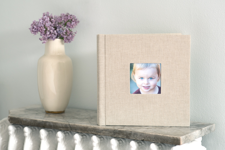 "This family chose a sweet 8x8"" Storybook album with a linen cover and cameo window."