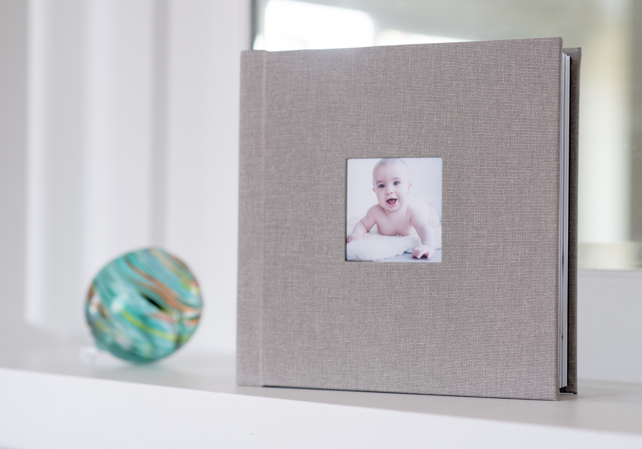 This FAMILY chose a LINEN STORYBOOK ALBUM WITH THEIR FAVORITE PORTRAITS FROM THEIR SESSION.