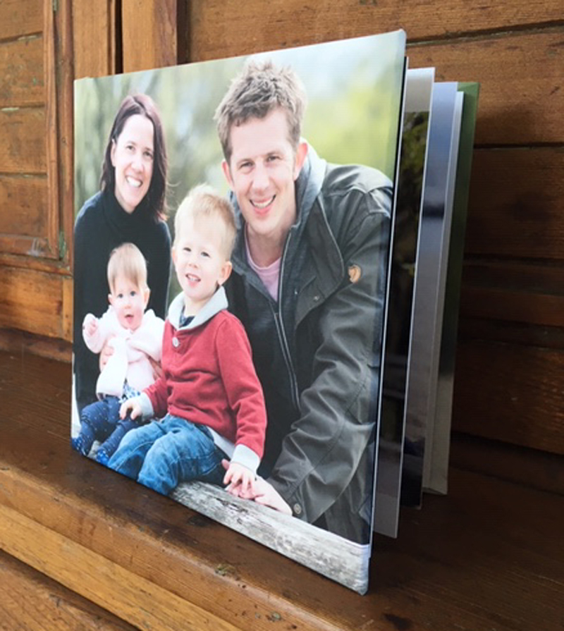 "This FAMILY chose a sweet 8x8"" STORYBOOK ALBUM of THEIR FAVORITE portraits FROM THEIR JERICHO BEACH PARK SESSIon."
