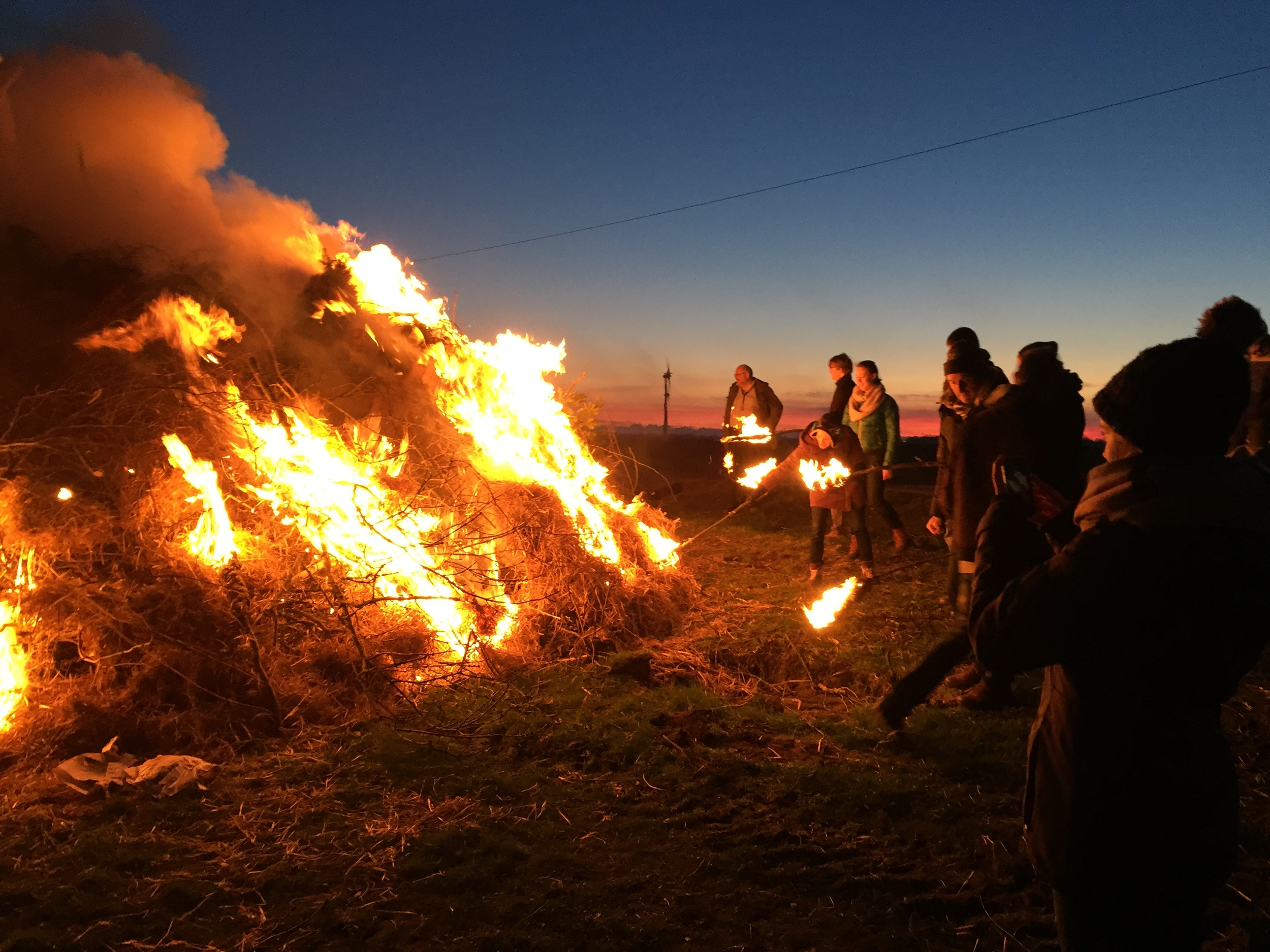 Igniting the bonfire in the 'magic hour'