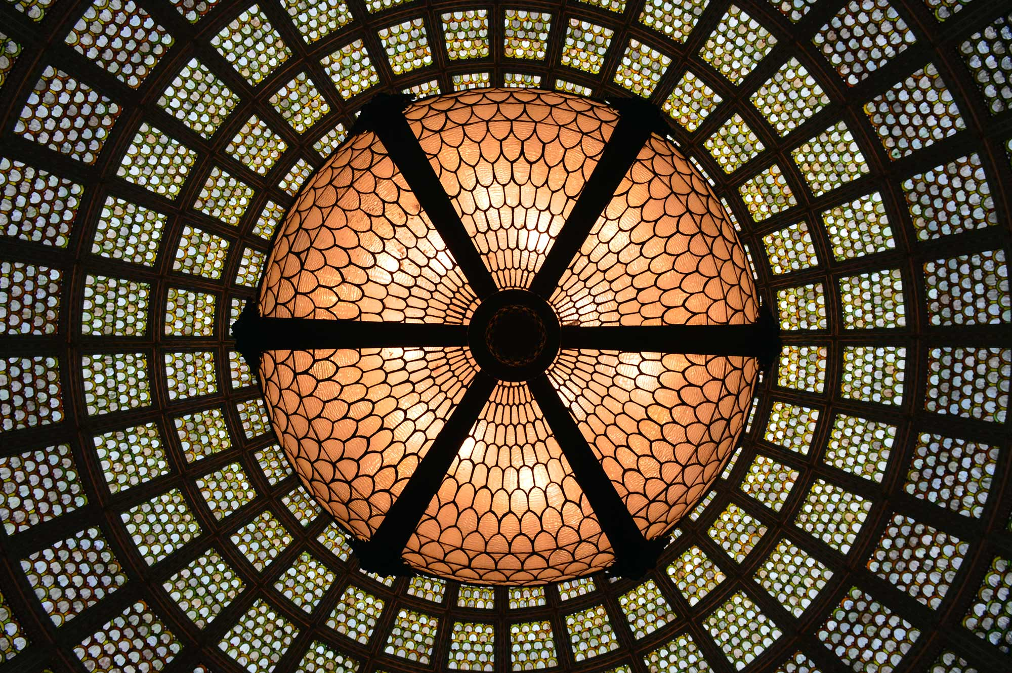 Light Fixture Hanging from Tiffany Stained-Glass Dome at Cultural Center