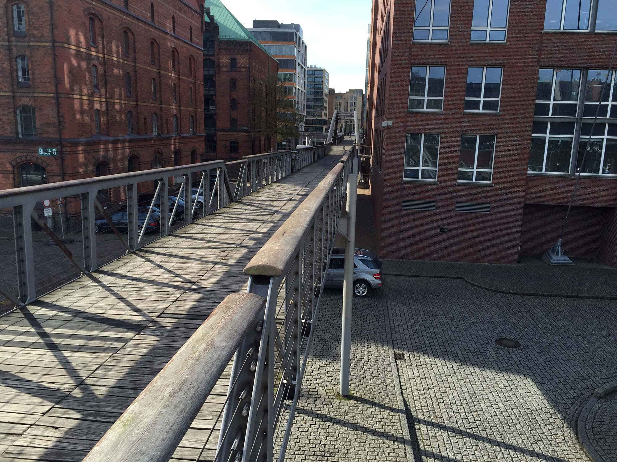 A series of elevated walkways and bridges are a new network of pedestrian access to the district's buildings during floods.