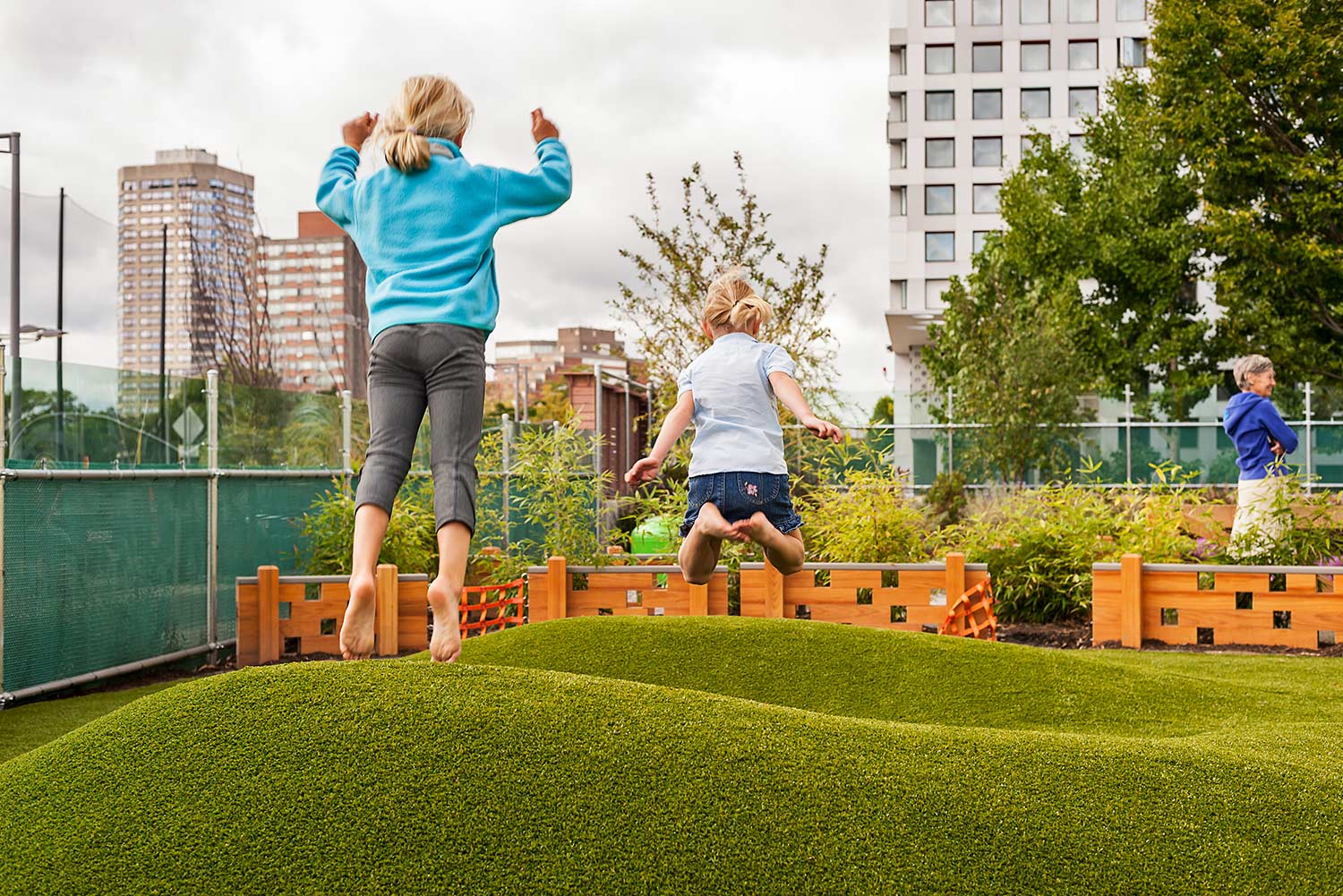 MIT-Childcare-Center_children-playing-turf-landform-Klopfer-Martin.jpg