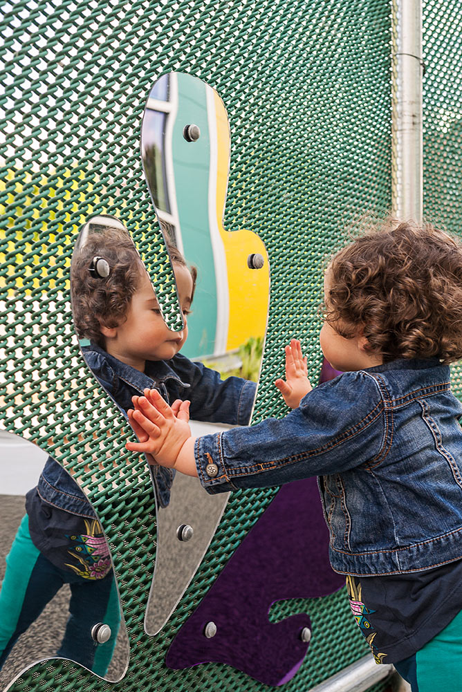 MIT-Childcare-Center_fence-mirror-reflection-playspace_Klopfer-Martin.jpg