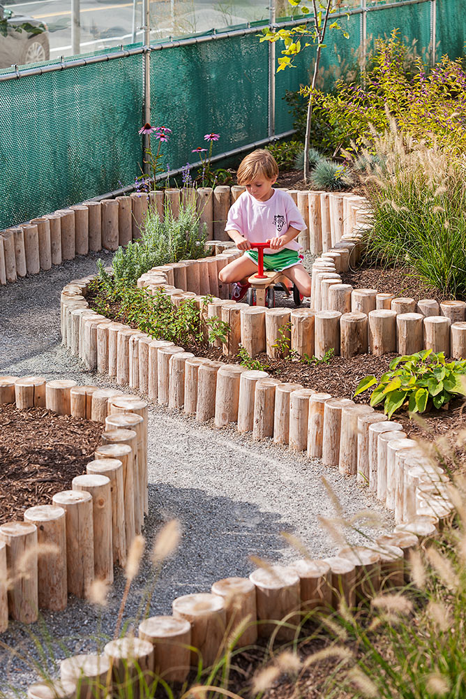MIT-Childcare-Center_landscape-childrens-adventure-planted-path_Klopfer-Martin.jpg