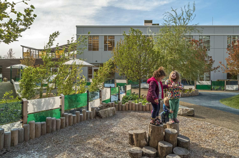 Partners-Childcare_wood-steps_colorful-kid-fence_Klopfer-Martin.jpg