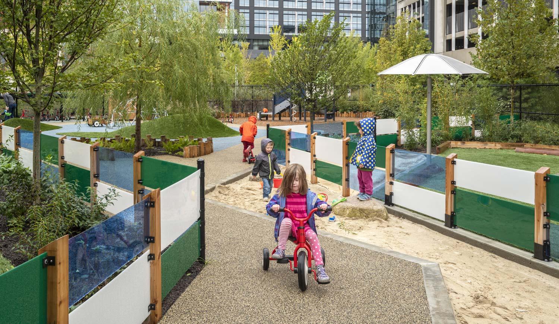 Partners-Childcare-Center_playscape-sandbox-landform-green-blue-wall_Klopfer-Martin.jpg