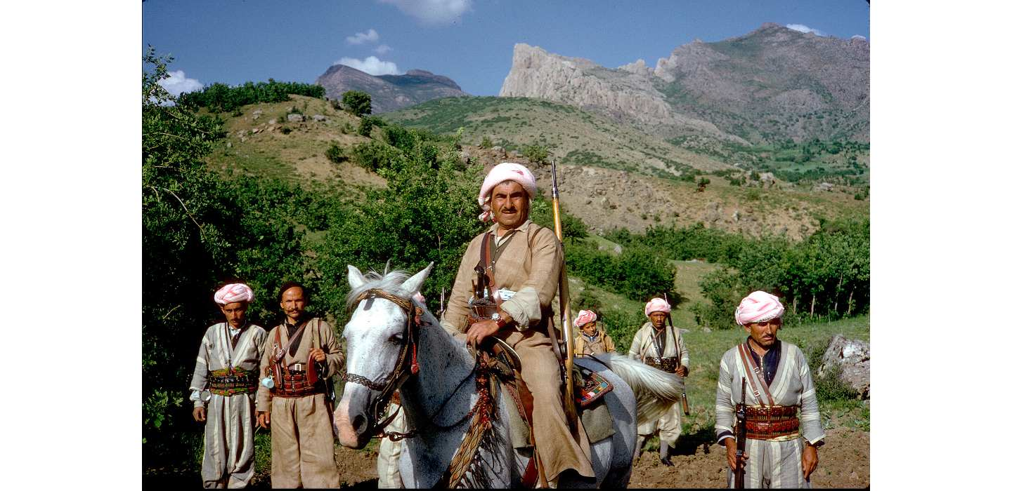 Kurdish leader Mullah Mustafa al-Barzani with men of the Peshmerga in the Kurdish mountains in 1965. (source: William Carter)