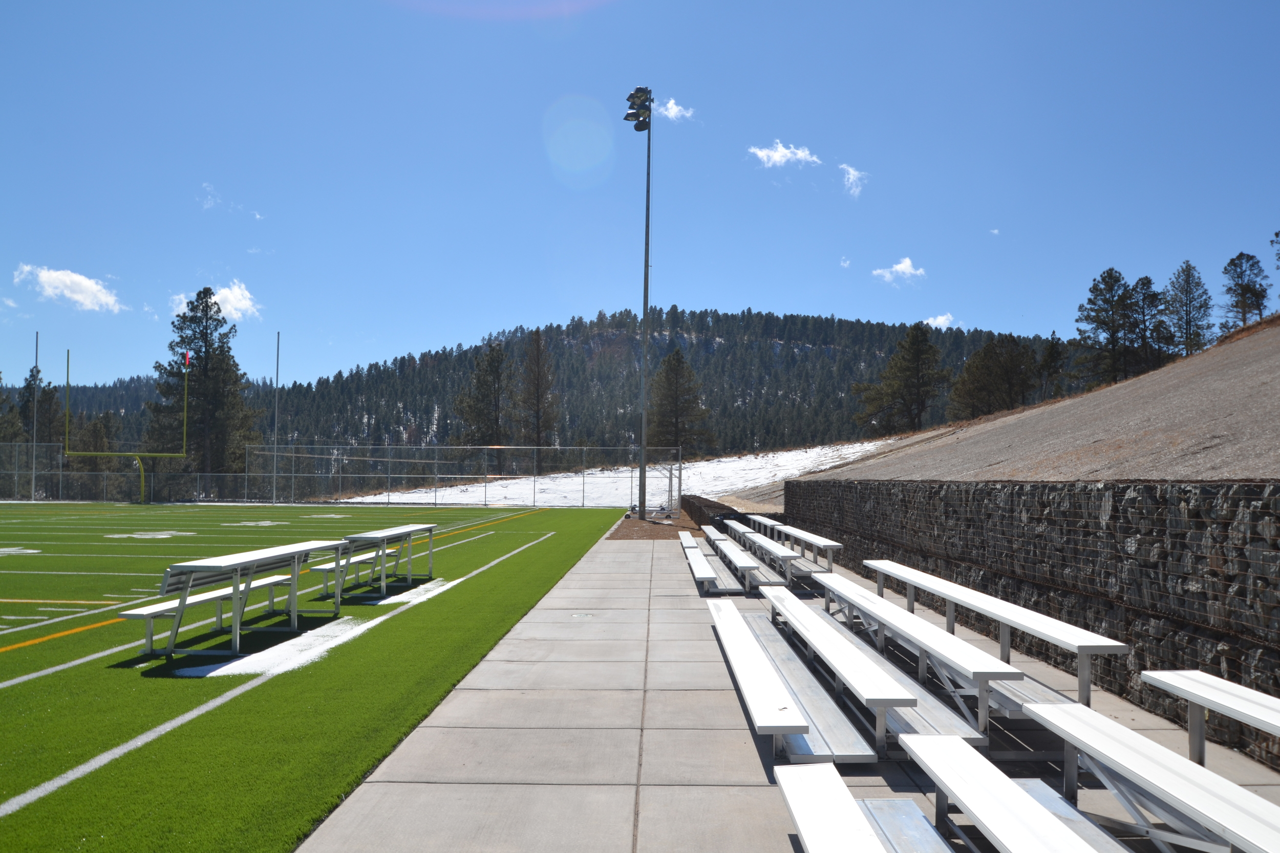 Artificial turf athletic field with bleachers