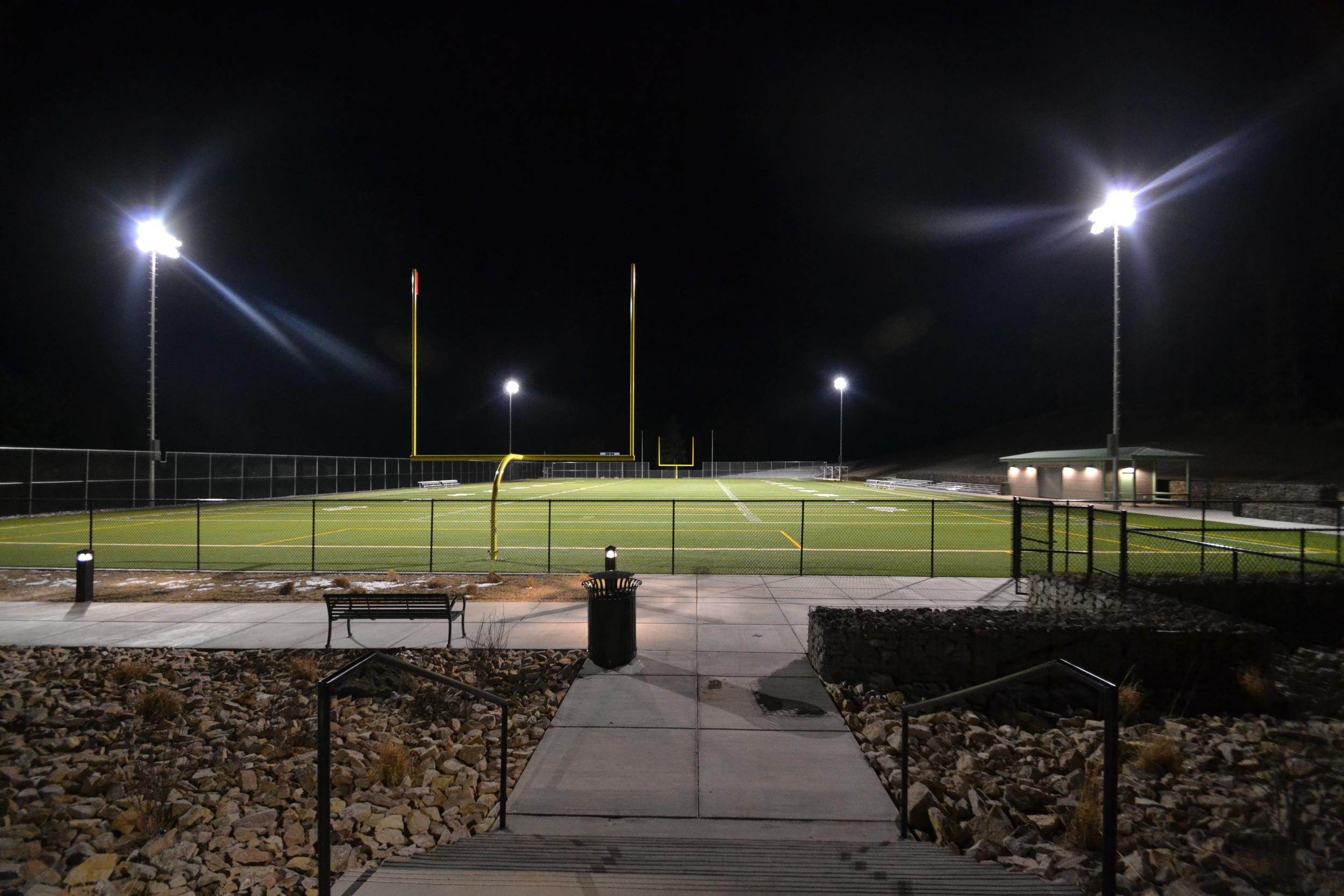 Artificial turf athletic field with night lighting
