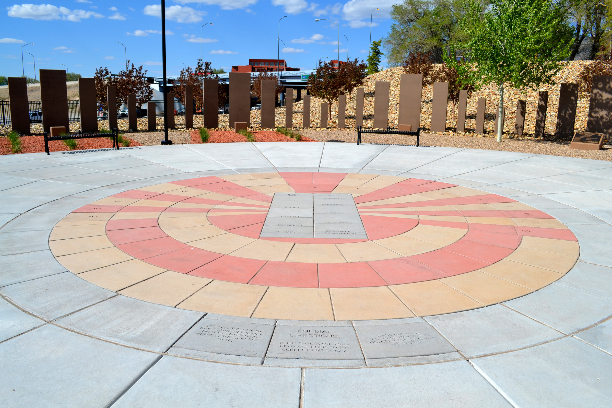 Colored concrete paves create plaza focal point