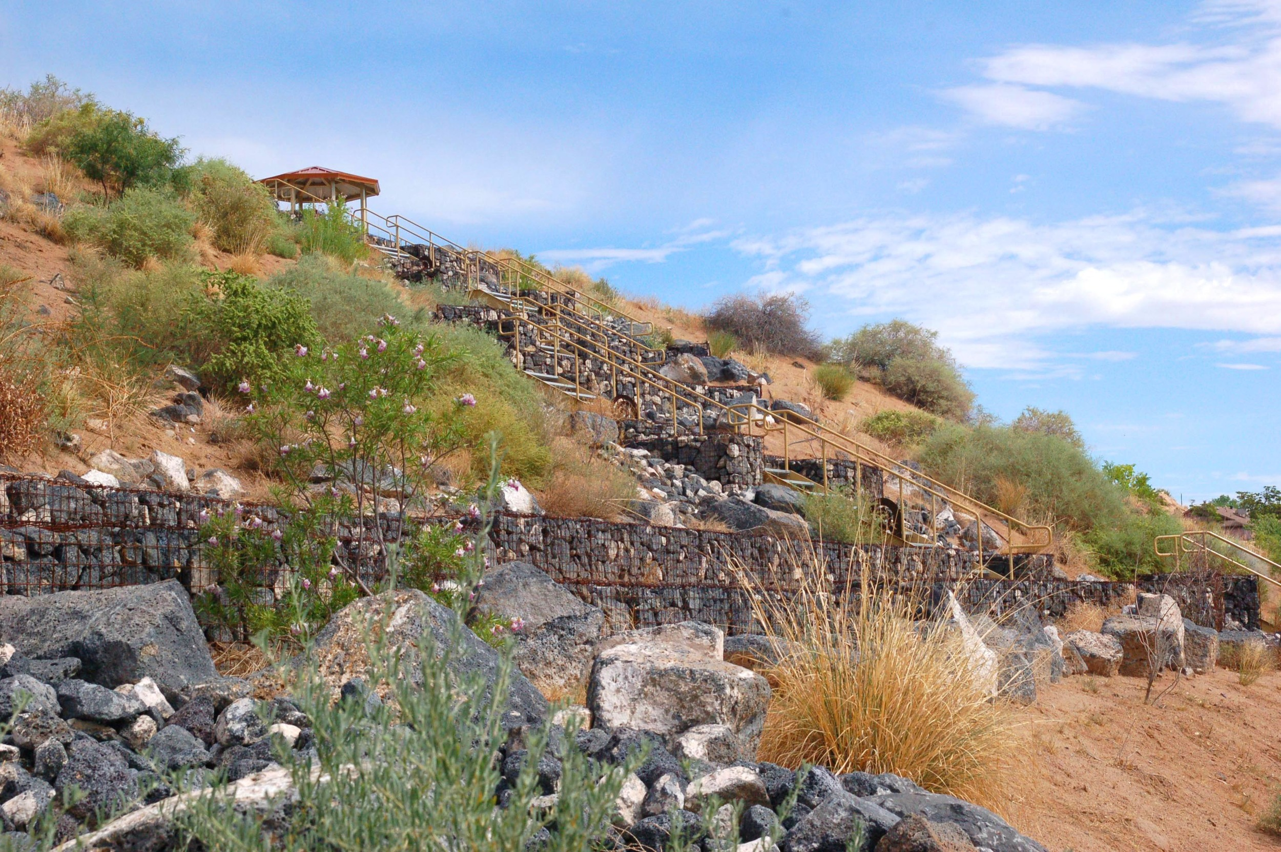 Locally available basalt used throughout site in gabion baskets