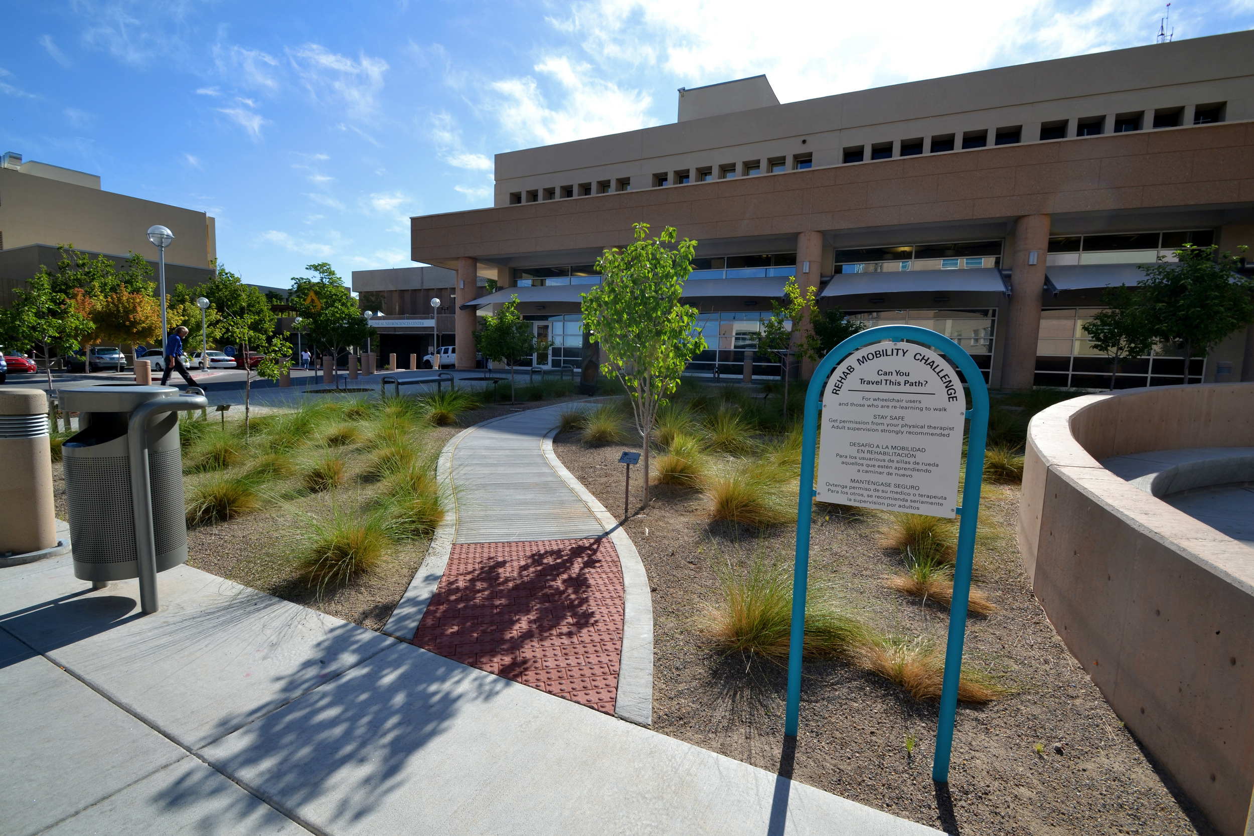 Mobility challenge walkway winds through the landscape of drought tolerant ornamental grasses