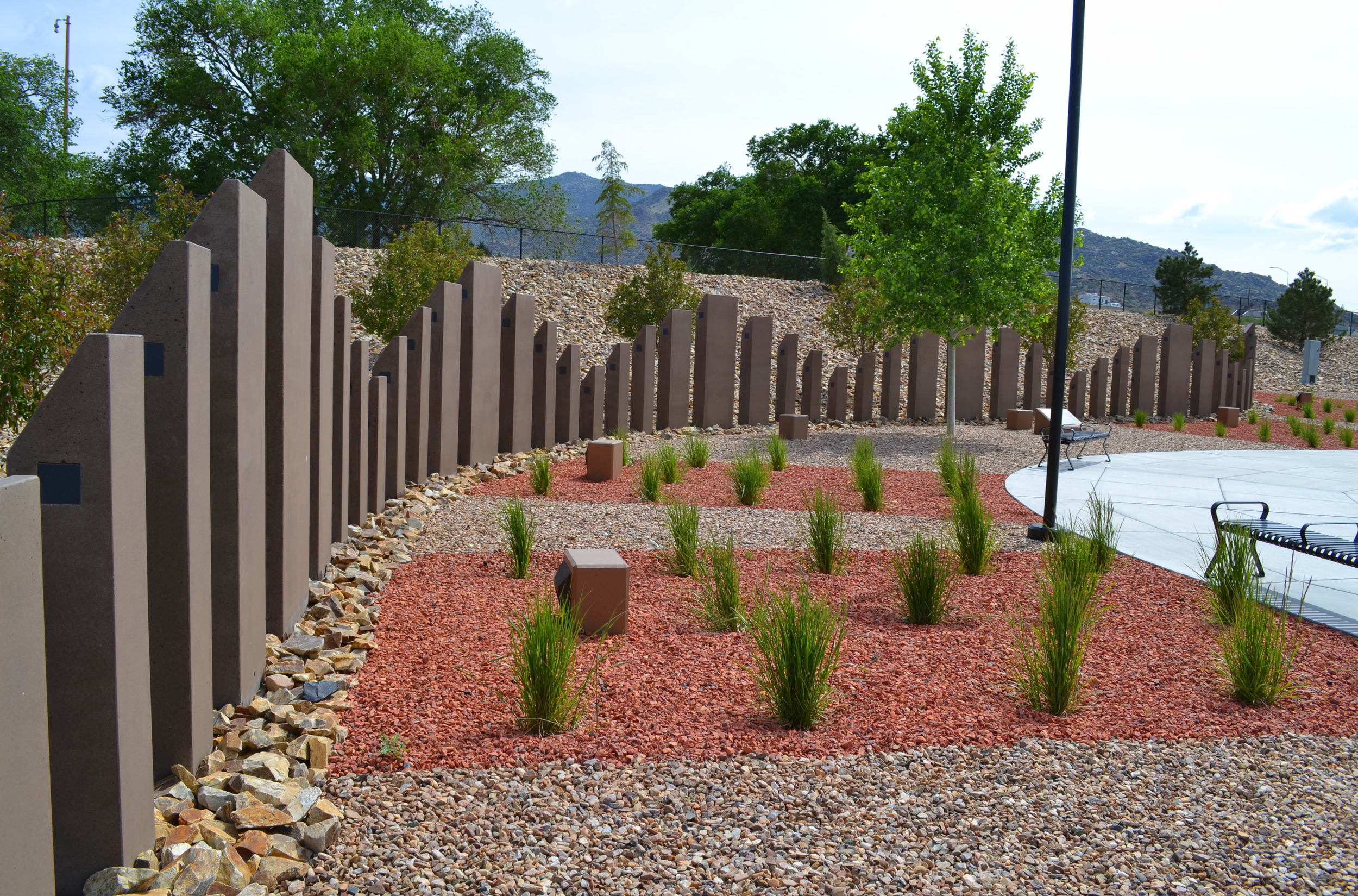patterns in stone ground cover accented by drought tolerant plants