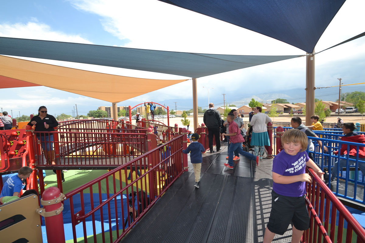 Extra wide access ramps to elevated play structure