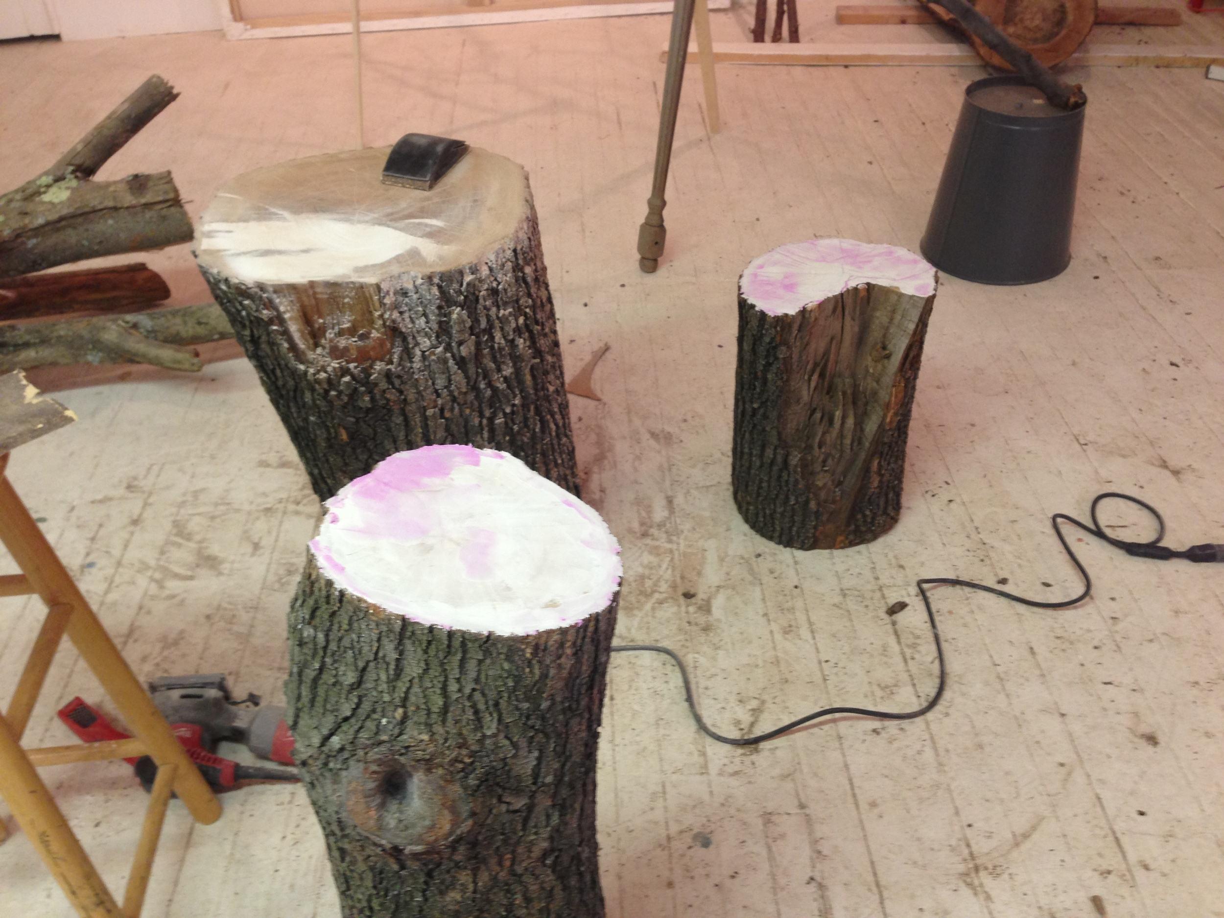 Patching and sanding tree stumps