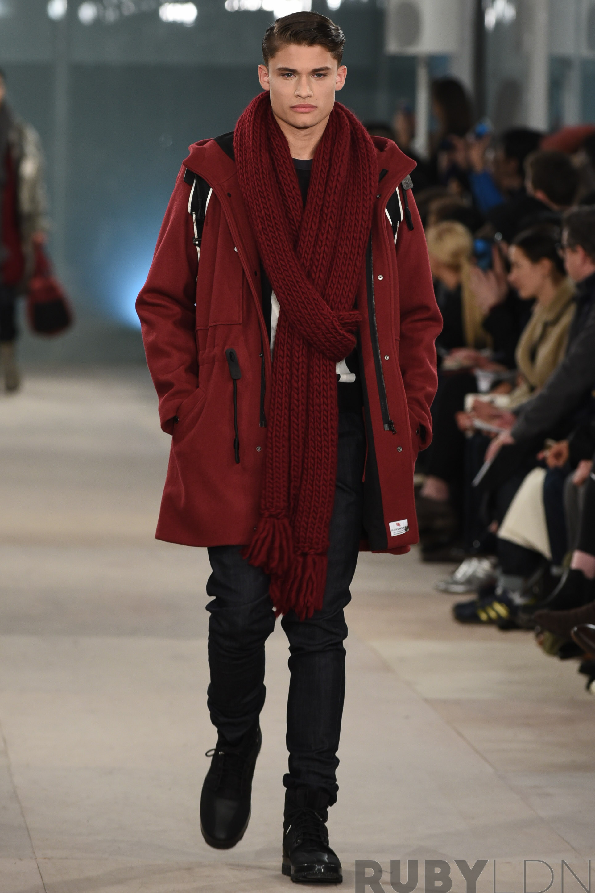Model walks down the catwalk wearing Christopher Raeburn's Autumn/Winter '16 collection