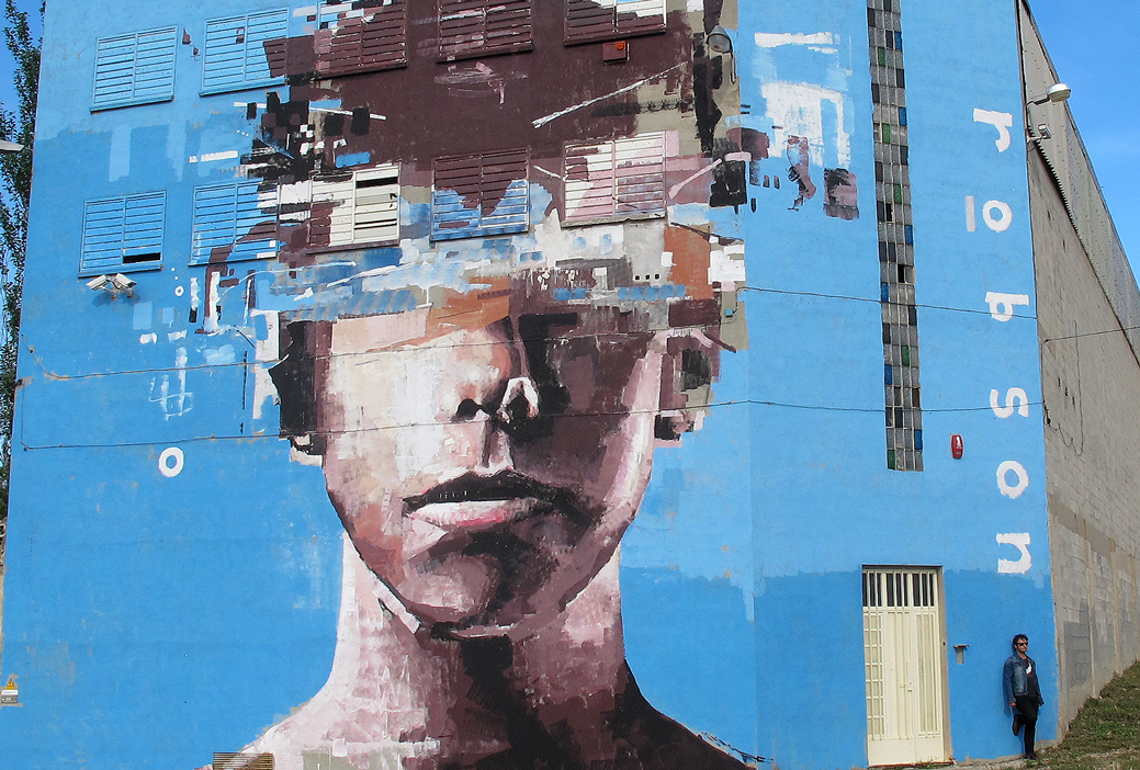"BRAD ROBSON MURAL IN BARCELONA SPAIN - Fine artist and painter Brad Robson from Australia did one of his interrupted portraits in rural Spain recently, and frankly, he likes it. ""It makes me want to do more like this around the world….I think the art has more impact in the remote areas, in the rural areas,"" he says.See more:"