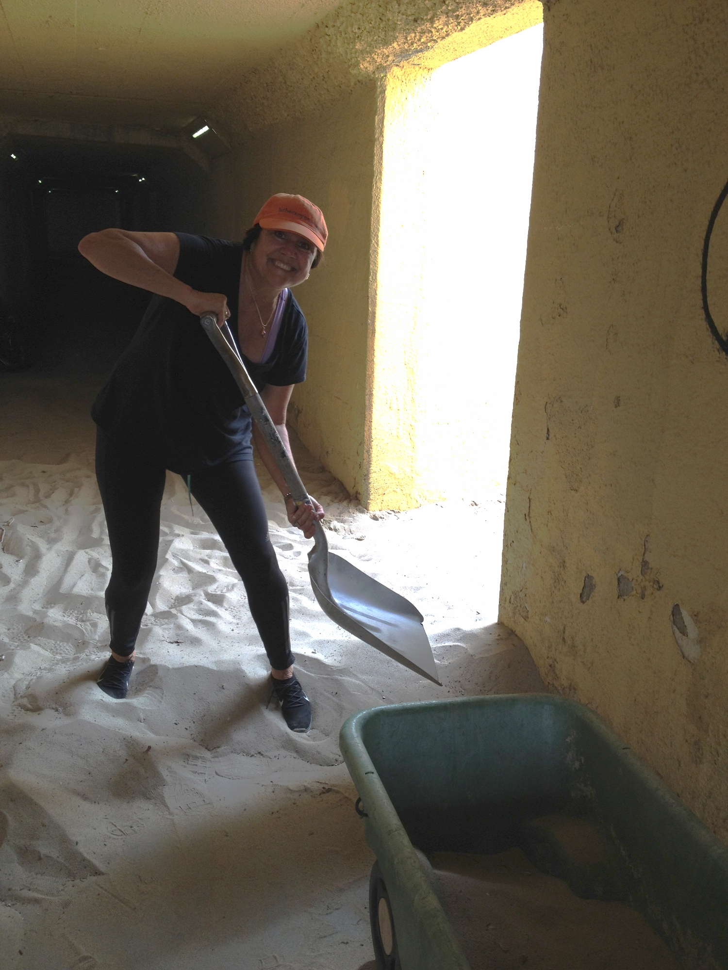 Sharon shoveling sand