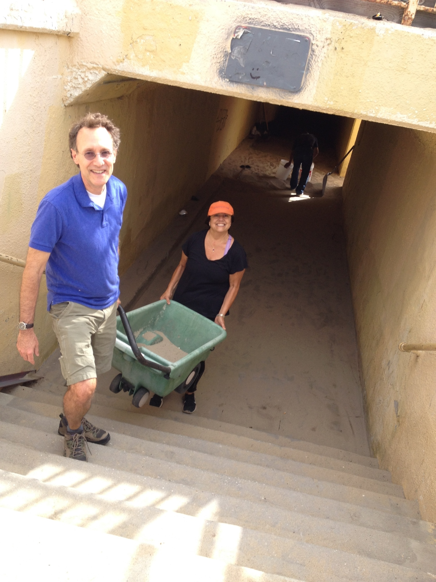 Wes and Sharon carting sand out of the tunnel