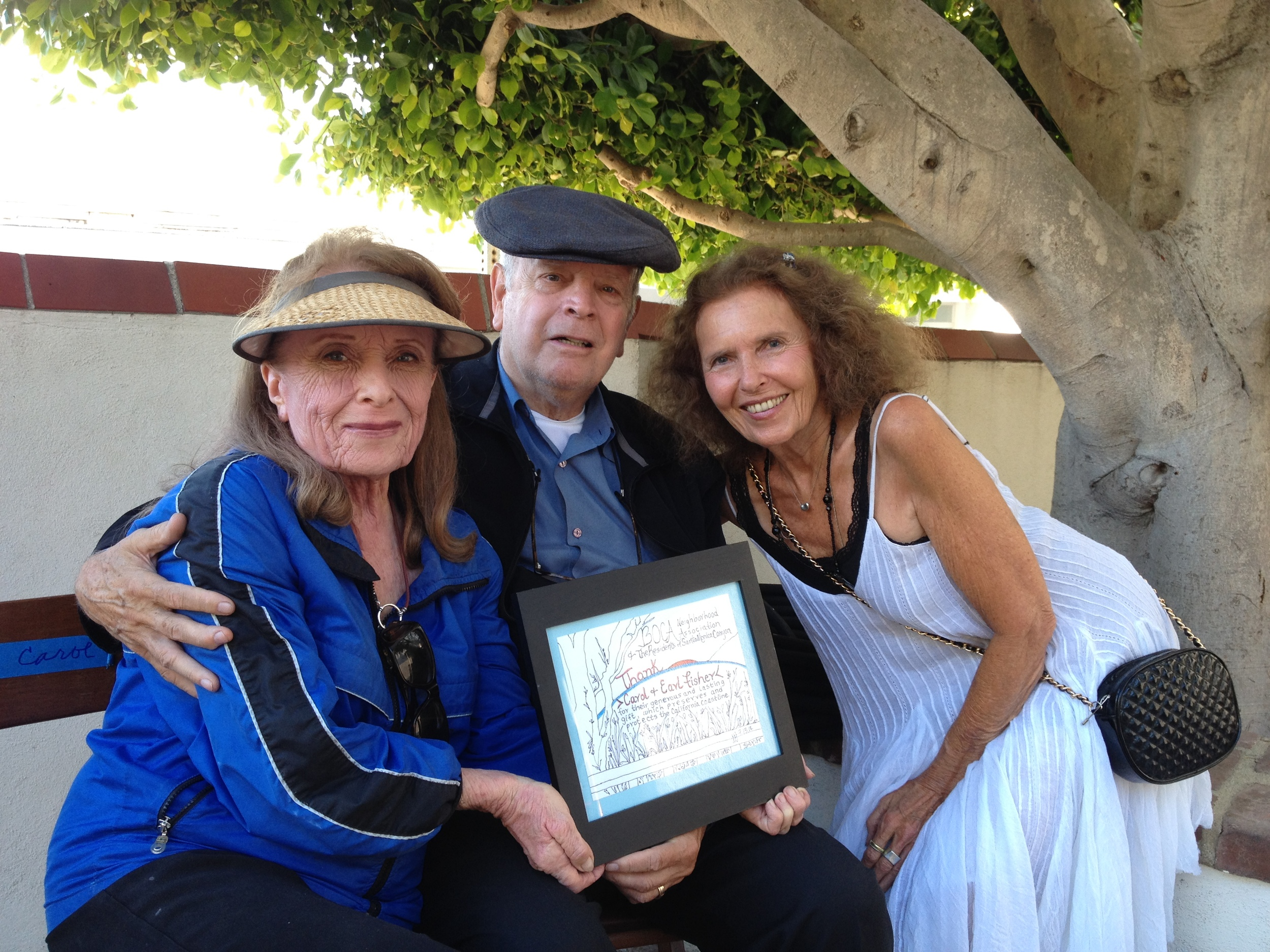 Carol and Earl Fisher receiving artwork from Judi Jensen