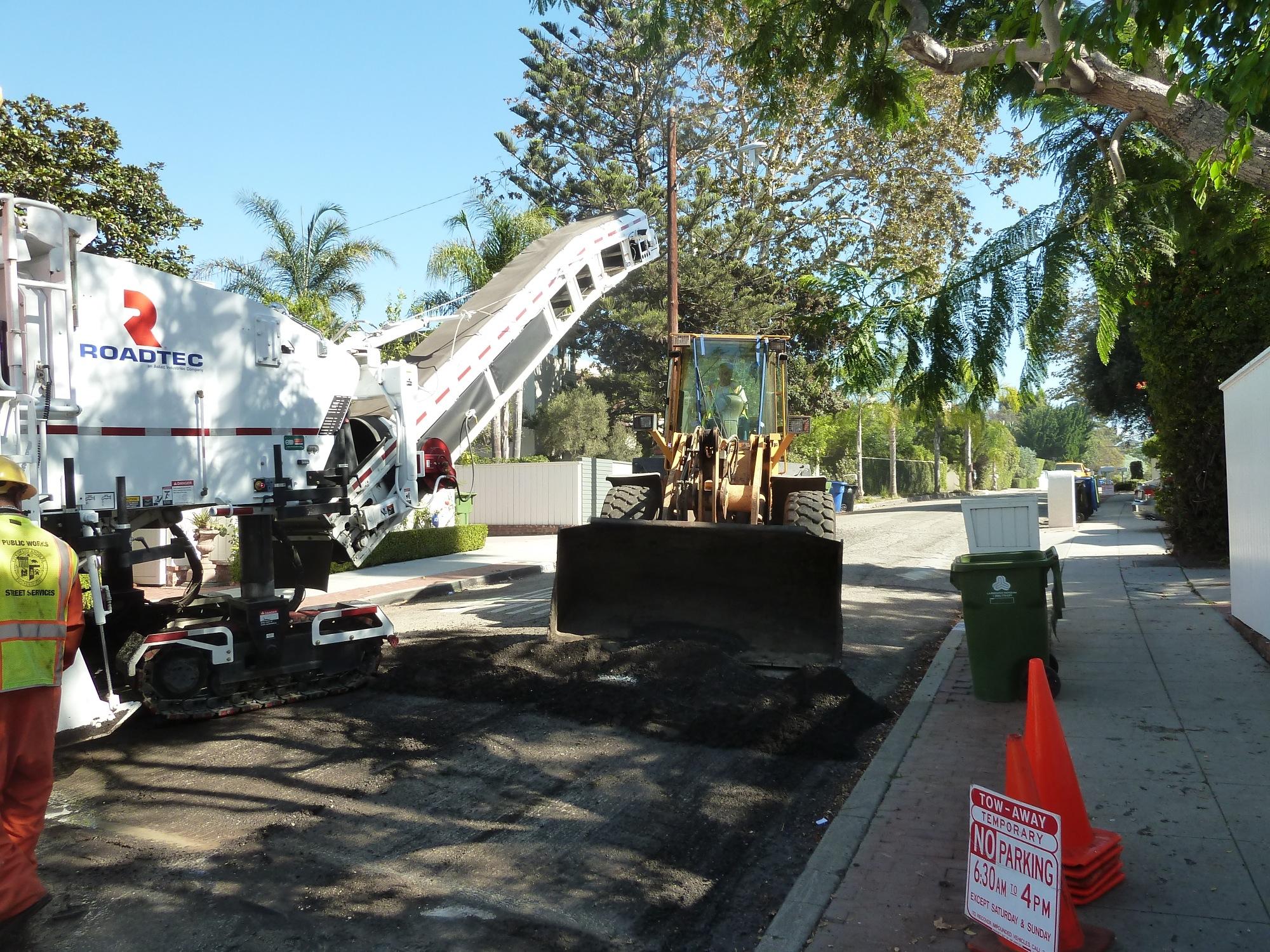 Removing the milled asphalt