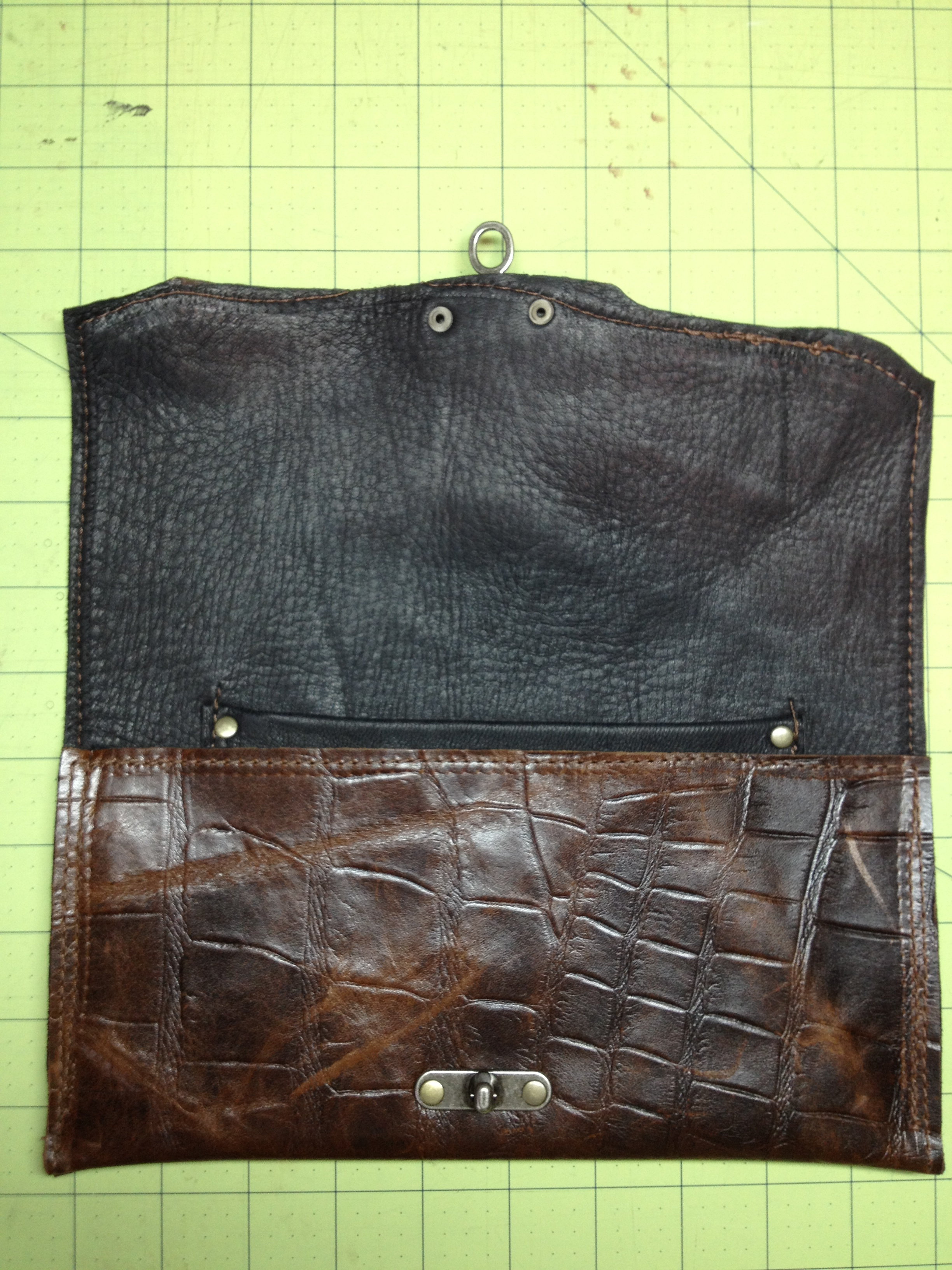 Textured clutch-flap opened