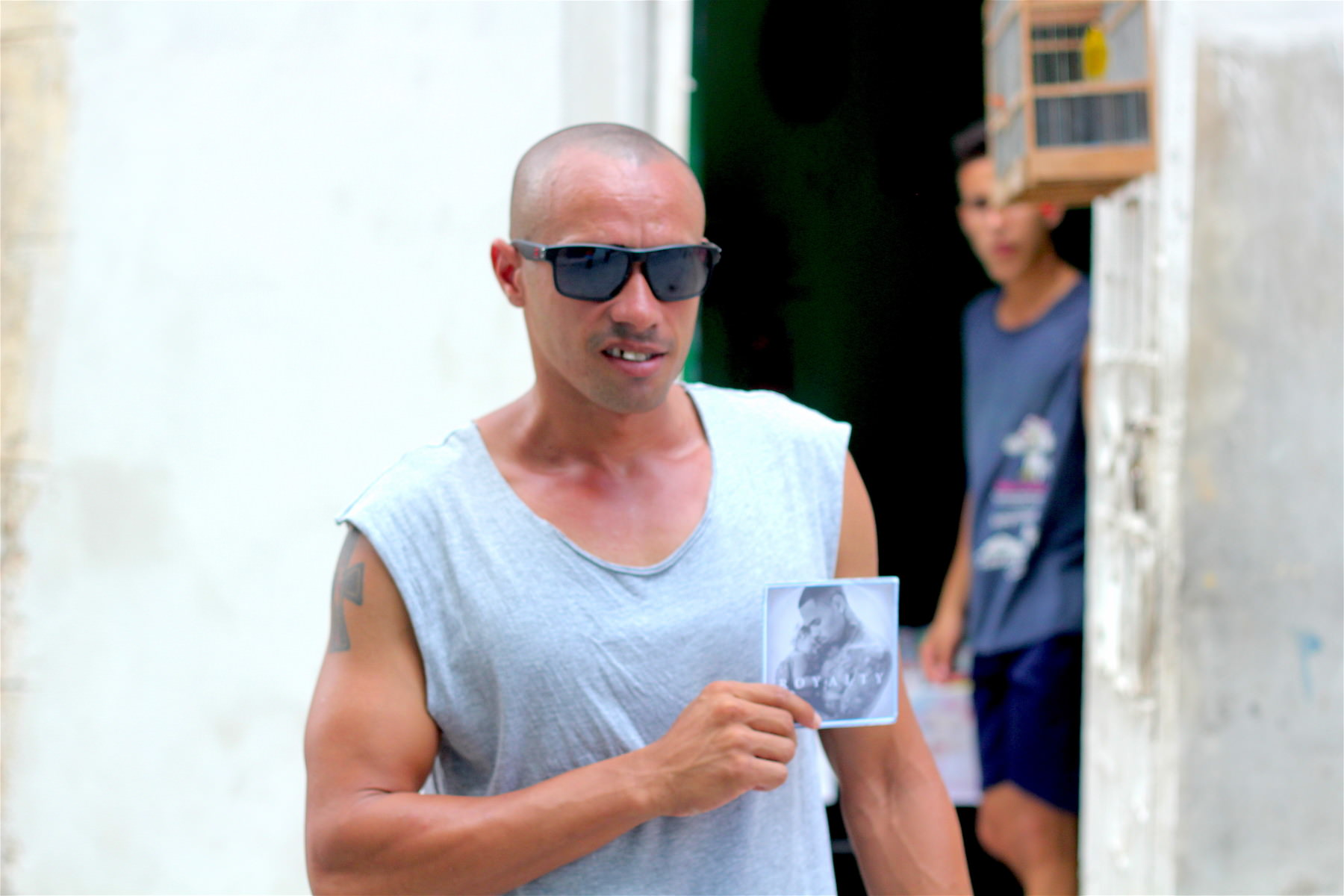 German, a resident of Havana, holding a bootleg copy of Chris Brown's most recent album, Royalty . Photo courtesy Donovan X. Ramsey